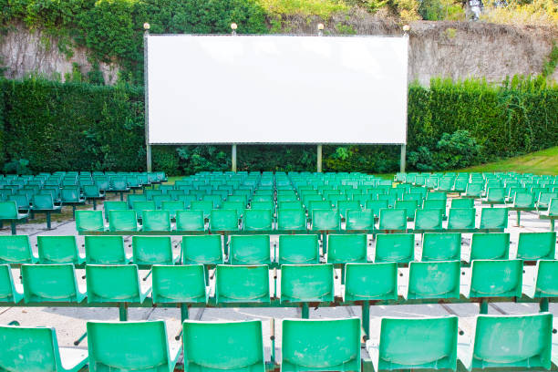Outdoor cinema with white projection screen stock photo