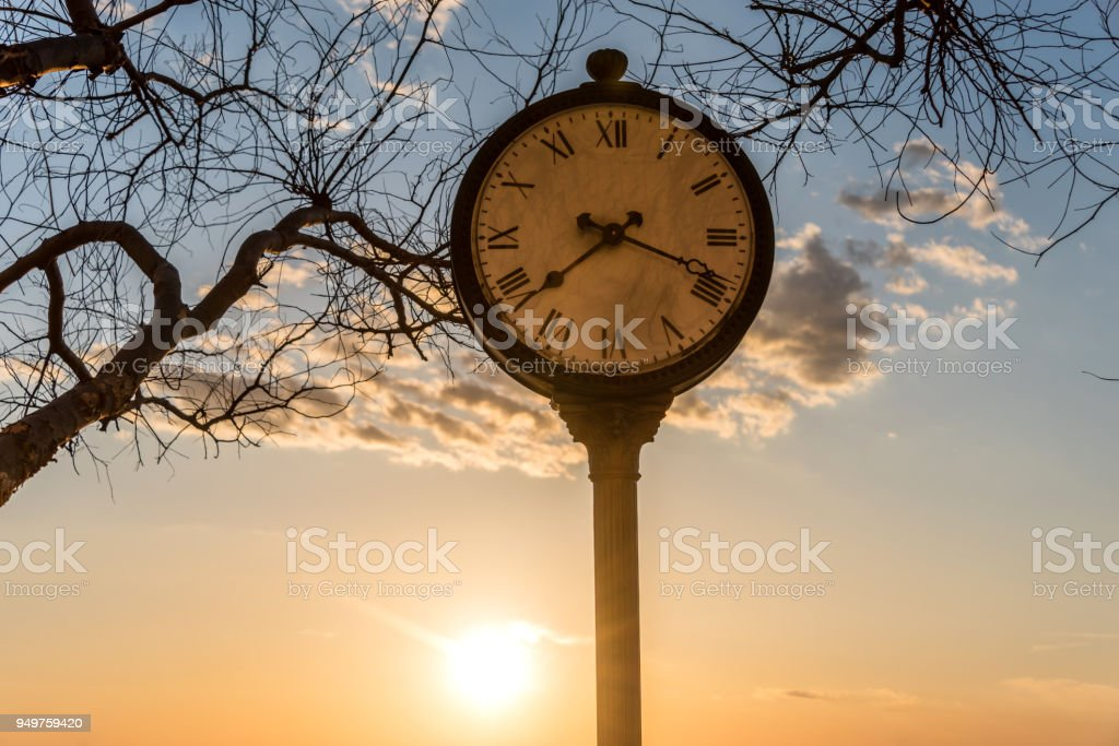 Outdoor Clock at Sunset stock photo