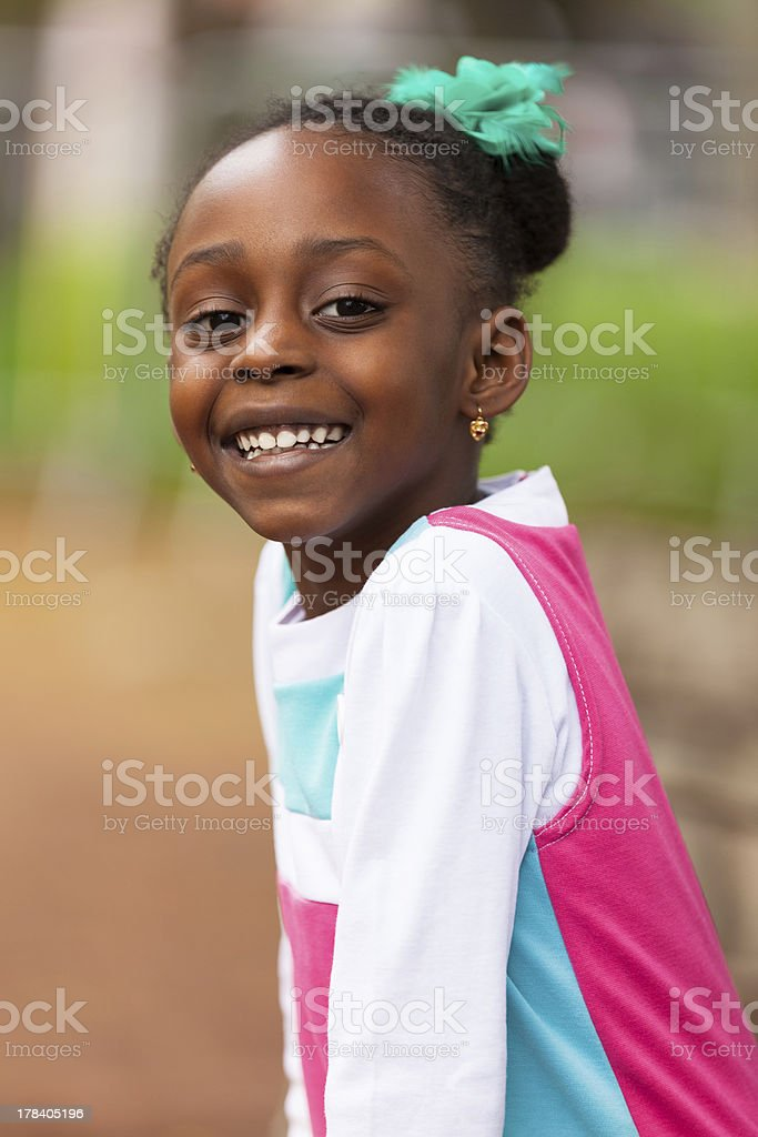 Outdoor close up portrait of a cute young black girl stock photo