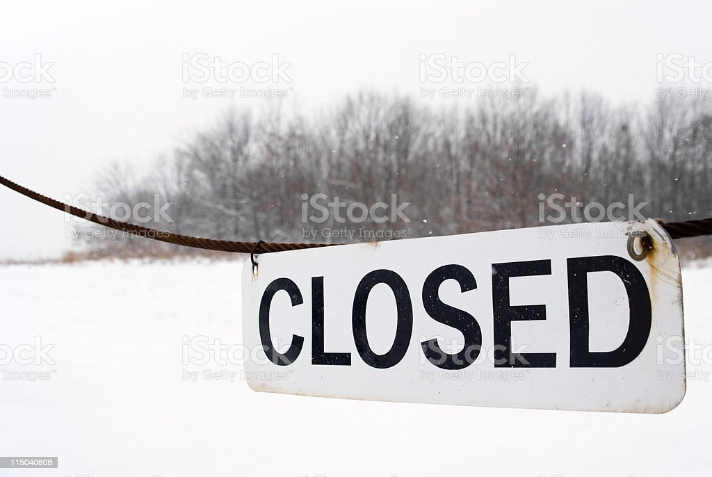 Outdoor Closed Sign for Snow Storm Hanging from Cable royalty-free stock photo