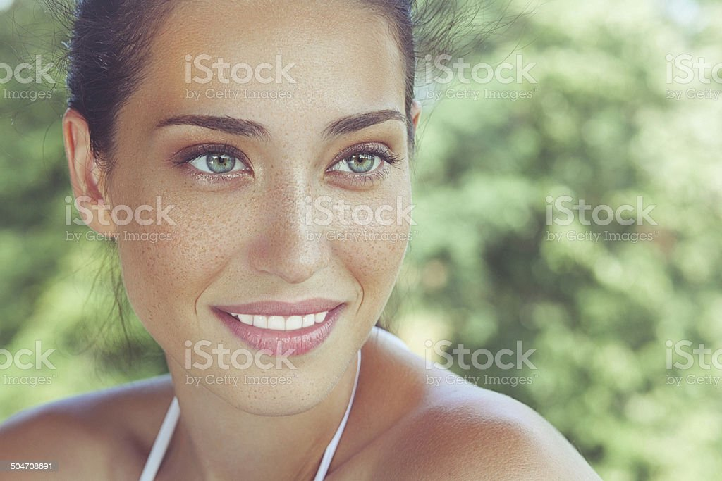 Outdoor, close-up, beauty portrait of a beautiful freckled woman stock photo