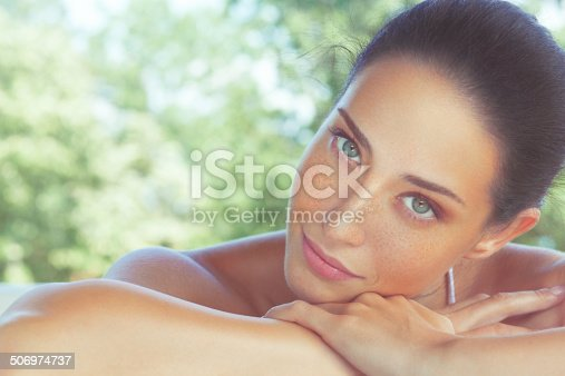 Outdoor, close-up, beauty portrait of a beautiful freckled woman. Developed from RAW; retouched with special care and attention; Small amount of grain added for best final impression; Ready made for print and web use;