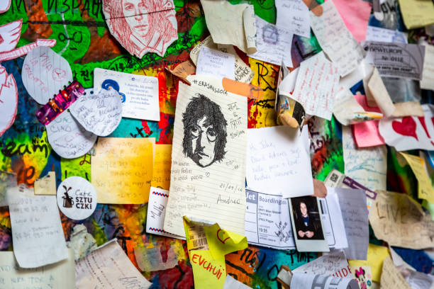Outdoor closeup of wall with drawings, notes, poems and messages. stock photo