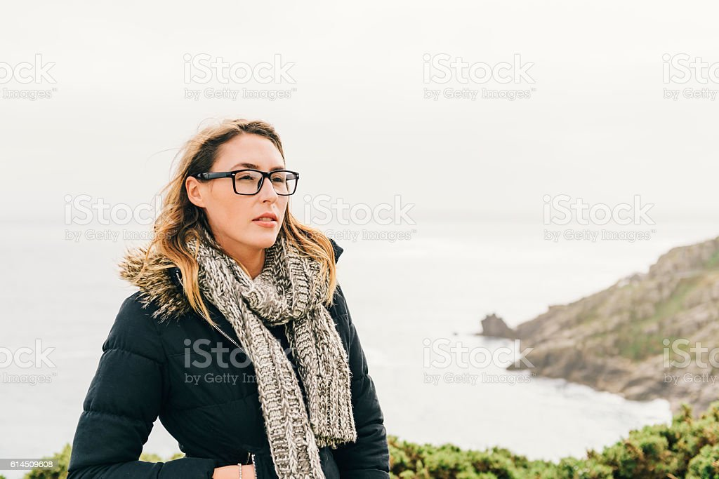 outdoor coastal Portrait of a Confident young Woman. stock photo