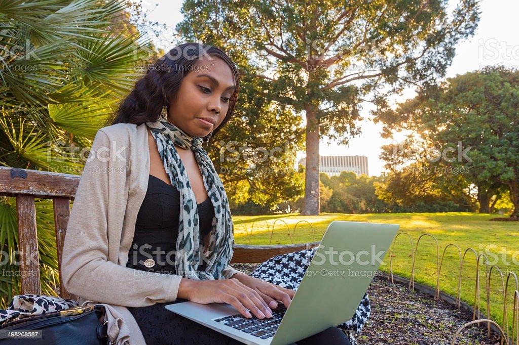 Outdoor Computer Aboriginal Woman stock photo