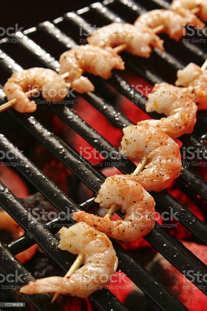 Outdoor cooking- Barbecue Shrimp Skewers royalty-free stock photo