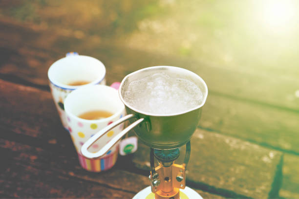 Outdoor cooking equipment. Tea in the morning. Holidays travel stock photo