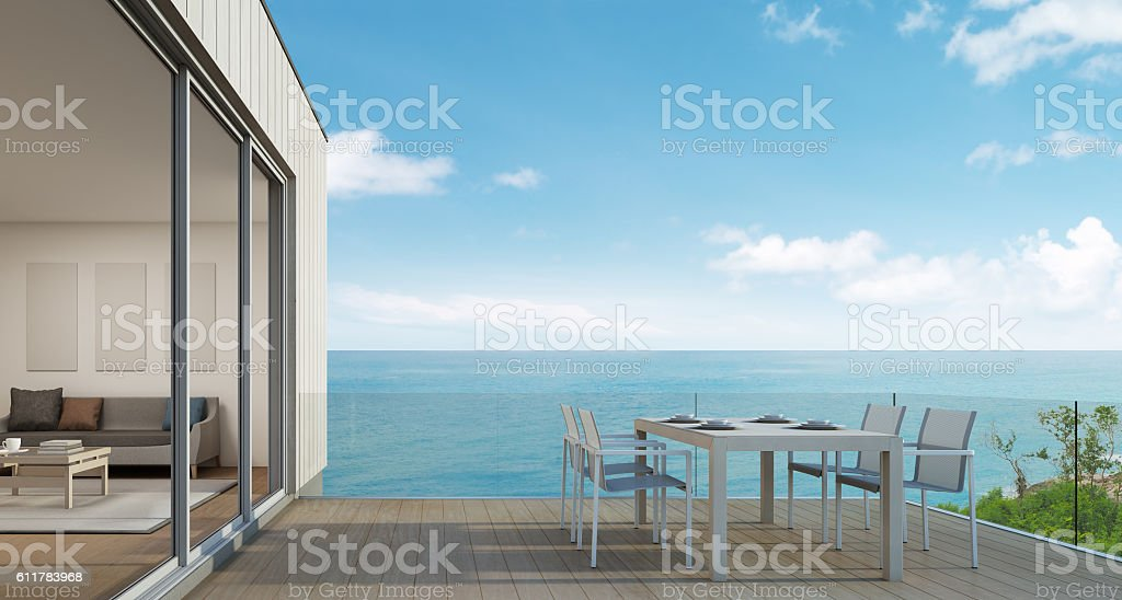 Outdoor dining, Beach house with sea view in modern design stock photo