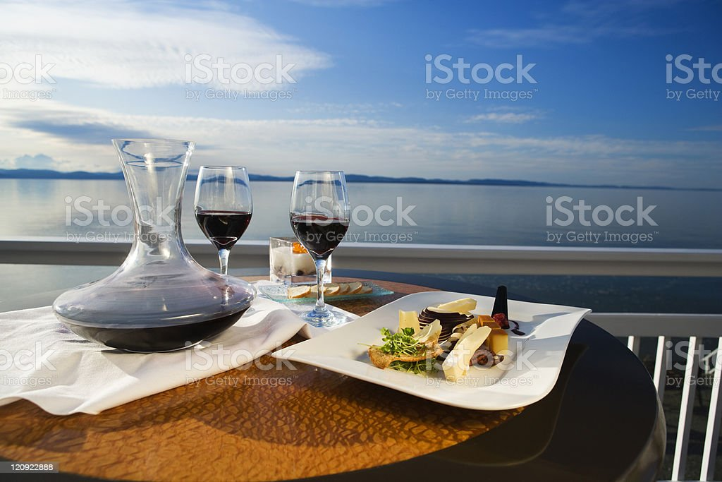 Outdoor dining with wine overlooking the water stock photo