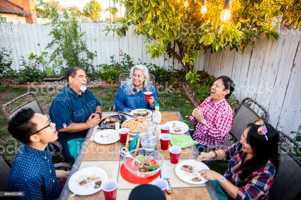 Outdoor Dinner on Beautiful Summer Evening stock photo