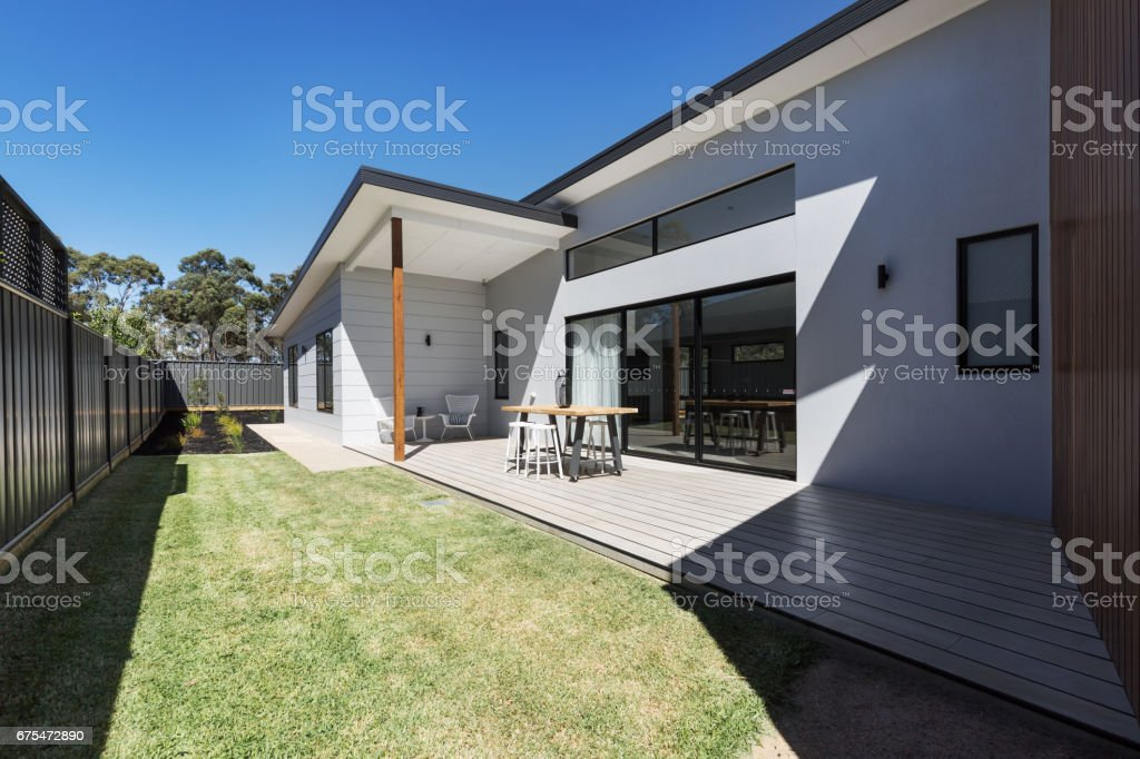 Outdoor entertaining deck and lawn of a new home stock photo