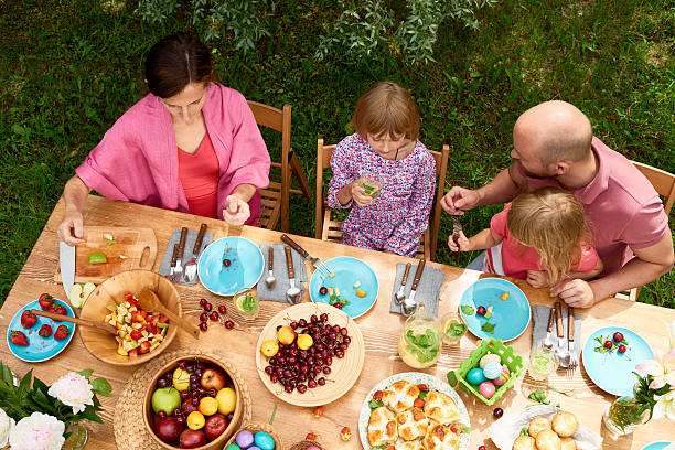 outdoor family brunch - easter brunch stock photos and pictures