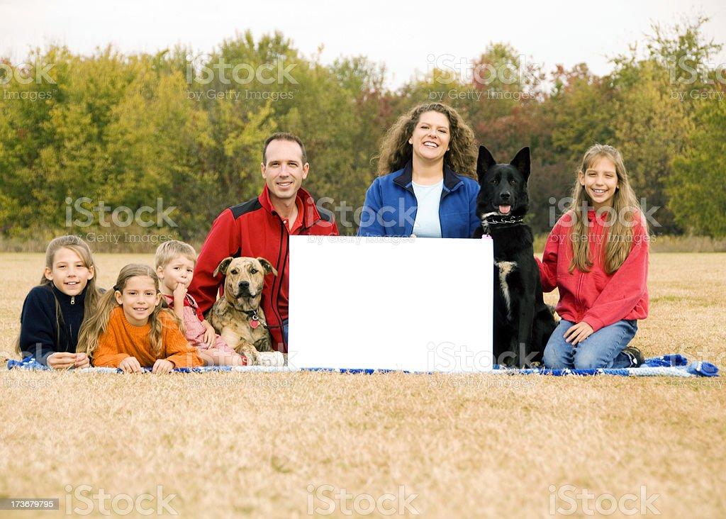 Outdoor family portrait with Blank sign for copy stock photo