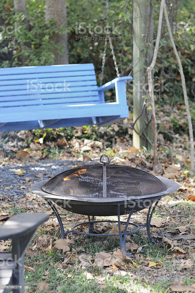 Outdoor fire by blue swing royalty-free stock photo