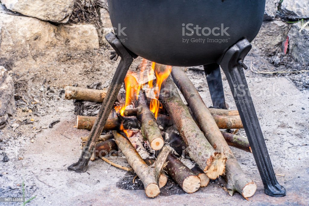 Outdoor Fireplace Under A Castiron Pot With Roasts Barbeque Party