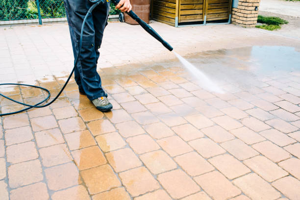 Outdoor floor cleaning with high pressure water jet - cleaning concrete block floor on terrace stock photo