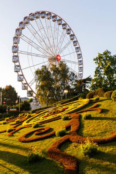 Outdoor flower clock and ferris wheel in Geneva, Switzerland stock photo