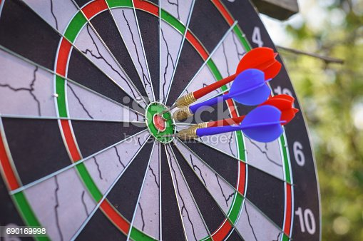 istock outdoor flying darts game with blurry green background 690169998