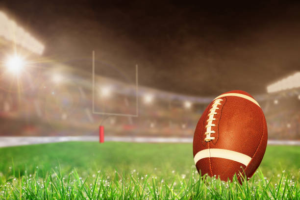 Outdoor Football Stadium With Ball on Grass and Copy Space stock photo