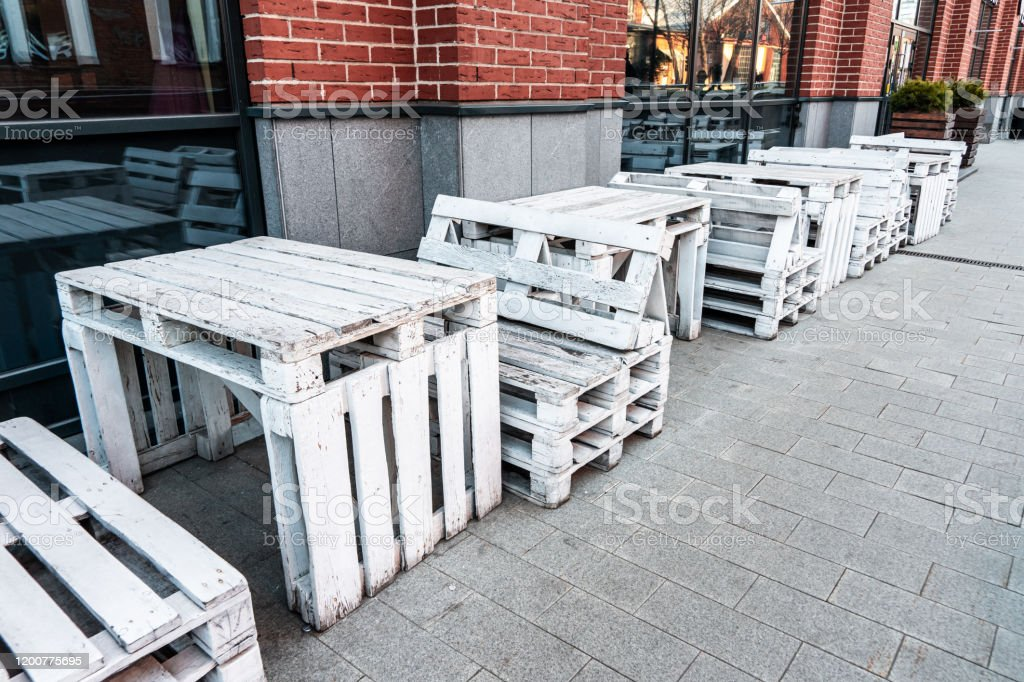 Outdoor Furniture For A Cafe From Painted Pallets Of White Color Conceptual Chairs And Tables Modern Urban Loft Design Furniture From Vintage Boards Stock Photo Download Image Now Istock