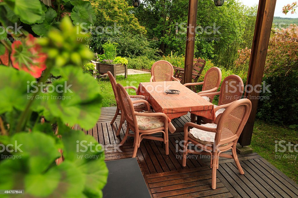 outdoor furniture on a decking stock photo