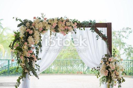 Outdoor garden wedding ceremony flower arch