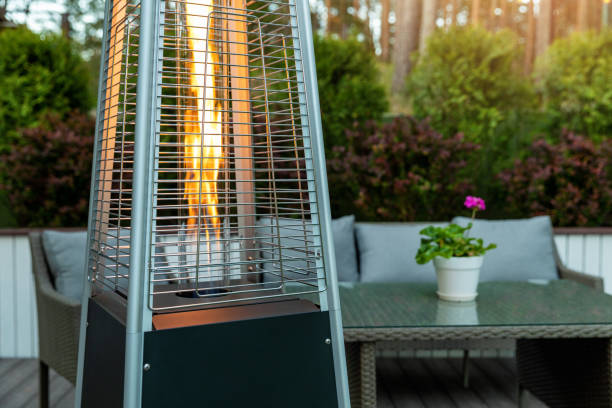 outdoor gas pyramid heater working on terrace stock photo