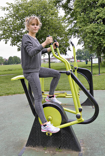 outdoor girl gymnast mini cross trainer demonstration - whiteway english outdoor girl stock photos and pictures