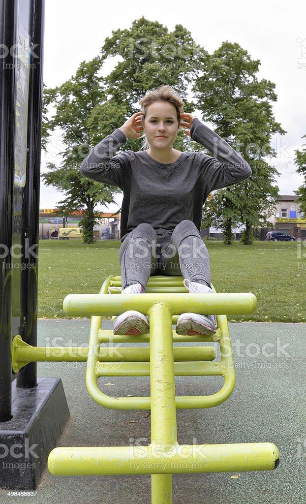 Outdoor girl gymnast bench press demonstration stock photo