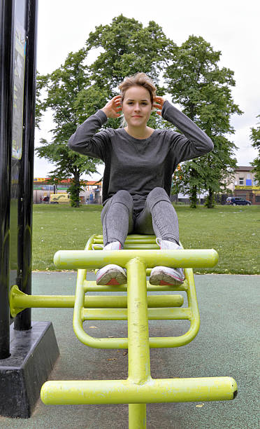 outdoor girl gymnast bench press demonstration - whiteway english outdoor girl stock photos and pictures