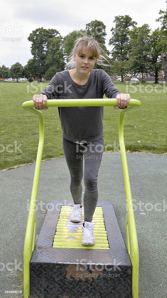 Outdoor girl gymnast roller treadmill demonstration stock photo