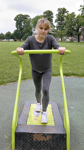 outdoor girl gymnast roller treadmill demonstration - whiteway english outdoor girl stock photos and pictures