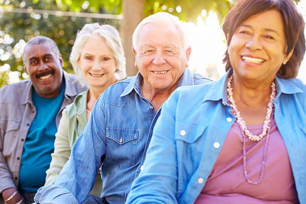 outdoor group portrait of senior friends - sağlıklı yaşlılar stok fotoğraflar ve resimler