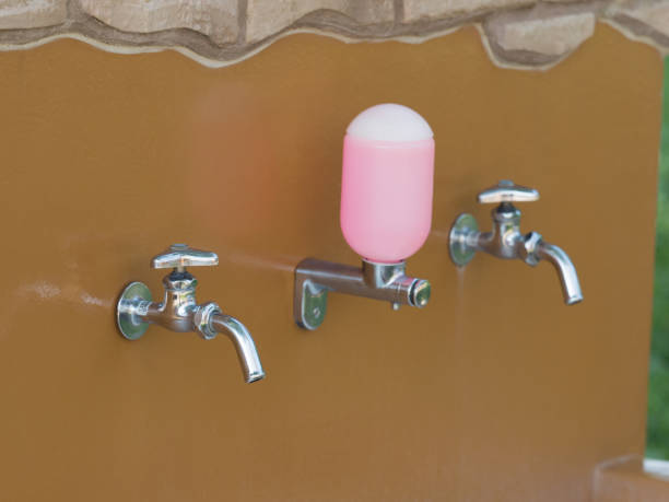 outdoor handwashing place - handwashing stock photos and pictures