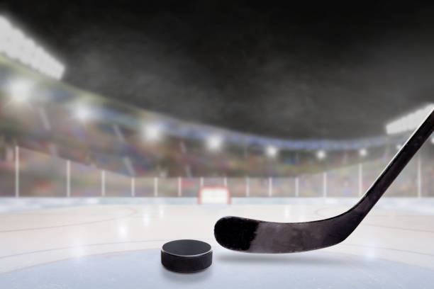 outdoor hockey stadium with stick and puck on ice - hockey stick stock pictures, royalty-free photos & images
