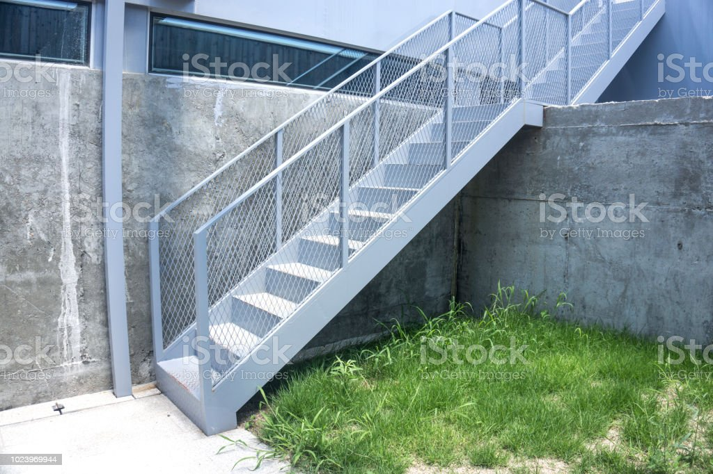 Outdoor Iron Staircase With Stainless Steel Handrail Iron Stairs With  Railing Stock Photo   Download Image Now