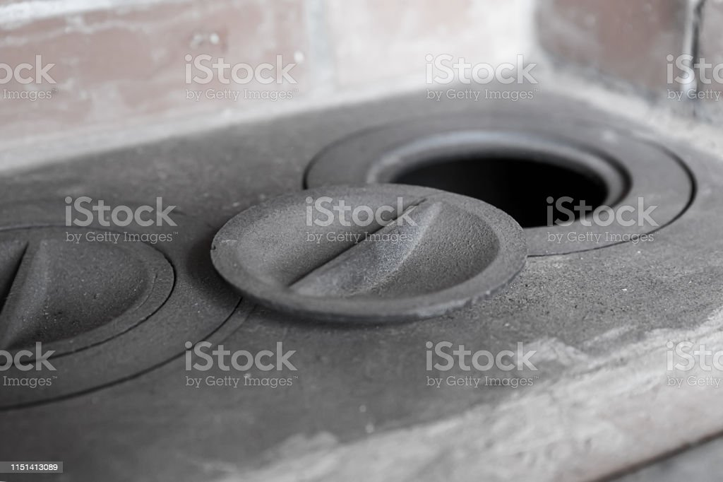 outdoor kitchen cooking natural products rustic iron hob close-up...