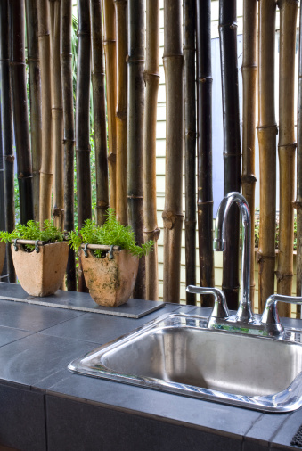Outdoor Kitchen Faucet With Bamboo Wall Stock Photo ...