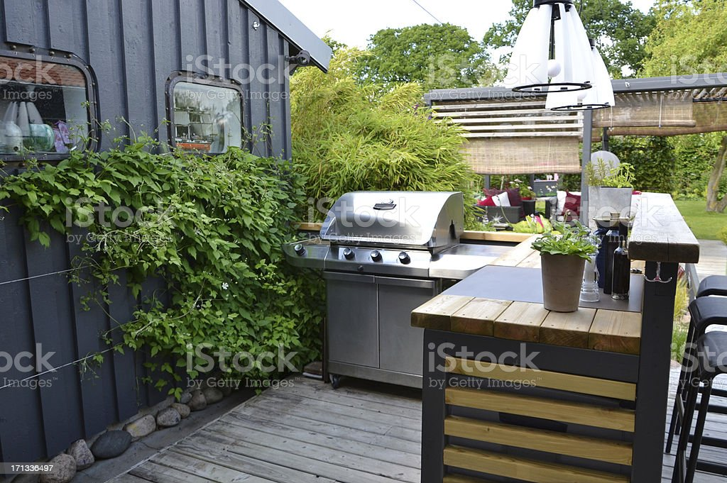 Outdoor kitchen with a stainless gas grill stock photo