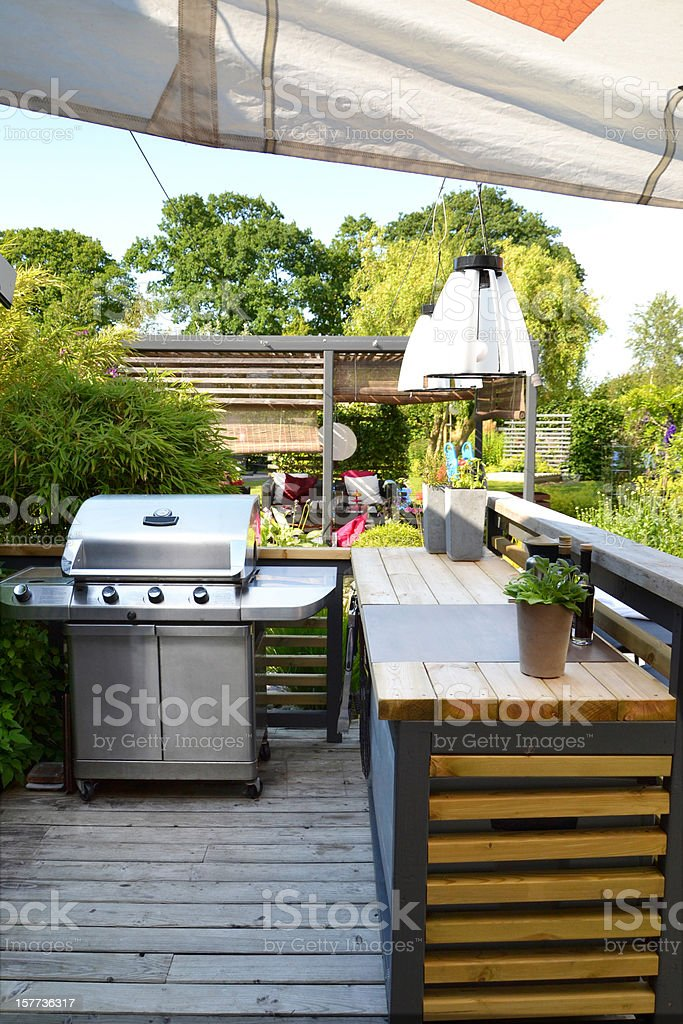 Outdoor Kitchen with stainless-steel gas grill stock photo
