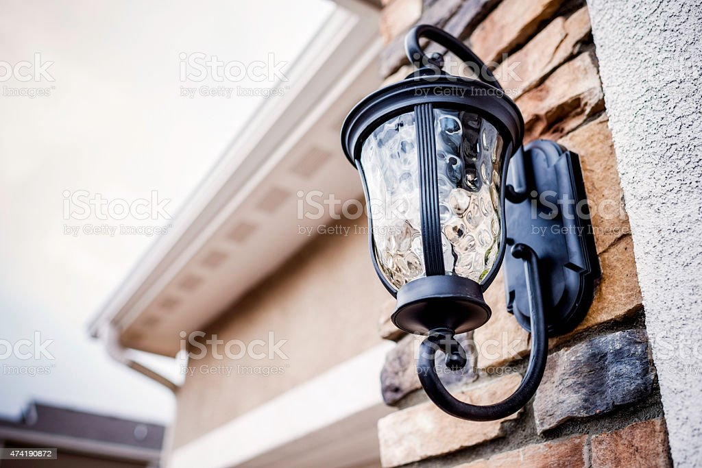 Outdoor light fixture on facade of house. Outdoor lighting. stock photo
