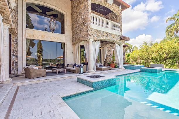 outdoor living with a beautiful view - naturstein terrasse stock-fotos und bilder