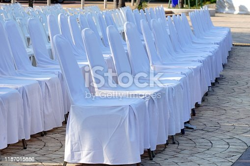 istock Outdoor Lots of white plastic chairs 1187015886