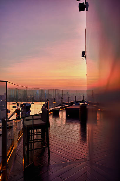 Outdoor lounge at sunset stock photo