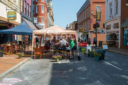 Staunton, VA, USA -- Sept 6, 2020. Restaurant patrons  dine under the shade of tents on a summer day in Staunton, VA.