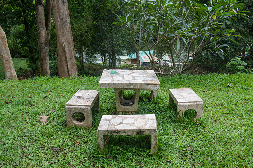 outdoor marble table and four chairs.