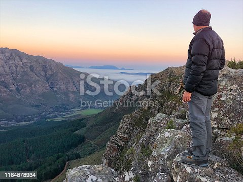 Outdoor mid-age Male looking out over Jonkershoek valley towards Table Mountain Stellenbosch Cape Town South Africa
