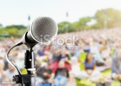 istock Outdoor music festival or concert: microphone with defocused audience 660031588