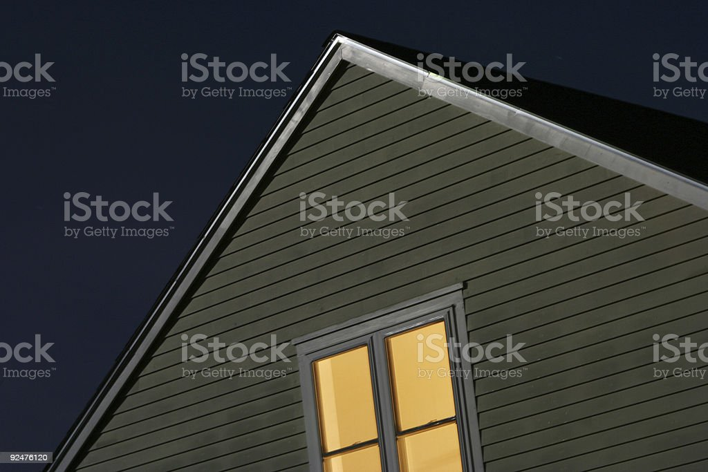 Outdoor night view of a house with lights on inside royalty-free stock photo