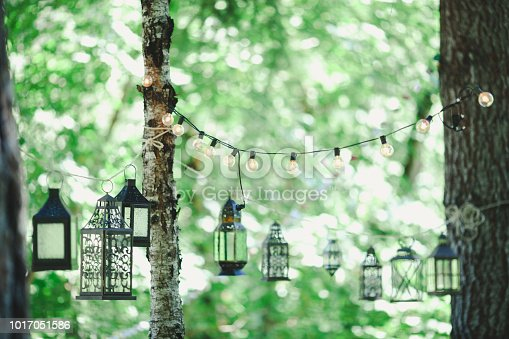 Hanging lighting for a formal outdoor wedding reception and party